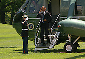 United States President Barack Obama salutes the Marine Guard as he returns to the White House in Washington, D.C. on Sunday, May 9, 2010 aboard Marine One after traveling to Hampton University in Virginia where he delivered the commencement address.  .Credit: Gary Fabiano / Pool via CNP