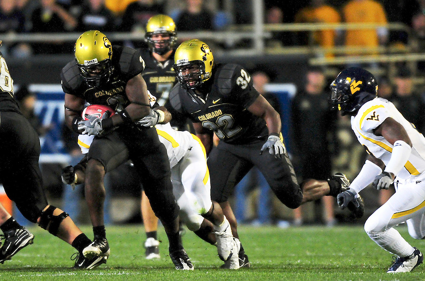 18 September 08: Colorado tailback Darrell Scott rushes against West Virginia. The Colorado Buffaloes defeated the West Virginia Mountaineers 17-14 in overtime at Folsom Field in Boulder, Colorado. For Editorial Use Only.