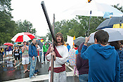 A man dressed as Jesus walks through the crowd during the N.C. Pride Parade in Durham on Saturday, Sept. 29, 2012, at the corner of Main and Broad streets.