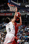 Real Madrid´s Diez (L) and CAI Zaragoza´s A. Fontet during 2013-14 Liga Endesa basketball match at Palacio de los Deportes stadium in Madrid, Spain. May 30, 2014. (ALTERPHOTOS/Victor Blanco)
