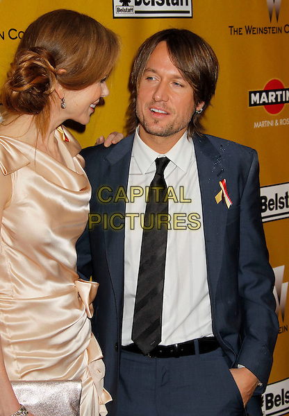 NICOLE KIDMAN & KEITH URBAN.Weinstein Company Post Golden Globe Party held at Bar210 & Plush Ultra Lounge at the Beverly Hilton Hotel, Beverly Hills, California, USA..January 17th, 2009.globes half length pink beige silk satin dress clutch bag gathered cream beige maxi profile black blue suit married husband wife profile .CAP/ADM/MJ.©Michael Jade/Admedia/Capital Pictures