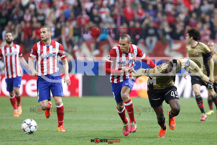 Atletico de Madrid´s Miranda (2R) and Milan´s Balotelli during 16th Champions League soccer match at Vicente Calderon stadium in Madrid, Spain. January 06, 2014. (ALTERPHOTOS/Victor Blanco)