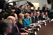 German Chancellor Angela Merkel (C) and Ivanka Trump (left center) particapate in a roundtable discussion on vocational training with United States and German business leaders lead by President Donald Trump (not seen) in the Cabinet Room of the White House in Washington, DC on March 17, 2017.       <br /> Credit: Photo by Pat Benic / Pool via CNP