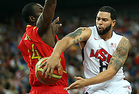 12.08.2012. London, England Deron Williams of USA (R) in action against Serge Ibaka of Spain during basketball final game in North Greenwich Arena at the London 2012 Olympic Games, London, Great Britain, 12 August 2012.
