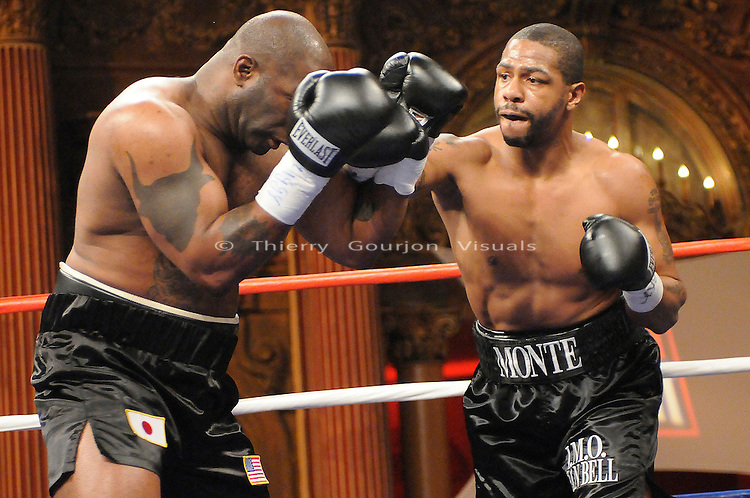 Bronx, NY, Dec. 6th, 2007: Monte Barrett (r) on the attack against Cliff Couser  during their 6 Rounds Heavyweights fight  at the Utopia Paradise Theater. Barrett won by 2nd round KO.