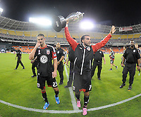 Dwayne De Rosario (7) of D.C. United presenting the U.S. Open Cup Trophy to the fans at  the end of the game.  The Chicago Fire defeated D.C. Untied 3-0, at RFK Stadium, Friday October 4 , 2013.