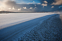 Snow coveres sand at Luskentyre beach, Isle of Harris, Western Isles, Scotland