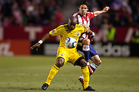 Columbus Crew forward Emilio Renteria (20) battles with defender Heath Pearce (3) of Chivas USA. Chivas USA and Columbus Crew played to a 0-0 tie at Home Depot Center stadium in Carson, California on  April  9, 2011....