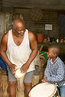 Man and his grandson playing traditional Garifuna music in the Garifuna village of Triunfo de la Cruz, Honduras...