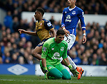 Joel Robles of Everton screams out as Alex Iwobi of Arsenal wheels away to celebrate scoring the second goal during the Barclays Premier League match at The Goodison Park Stadium. Photo credit should read: Simon Bellis/Sportimage