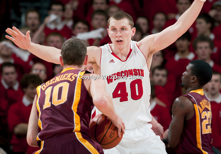 Wisconsin Badgers forward Jared Berggren (40) defends against Minnesota Golden Gophers forward Oto Osenieks (10) during a Big Ten Conference NCAA college basketball game on Tuesday, February 28, 2012 in Madison, Wisconsin. The Badgers won 52-45. (Photo by David Stluka)