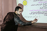 A photo taken on April 5, 2020, shows Syrian teacher gives an educational lesson online as a preventive measure amid fears of the spread of the coronavirus disease (COVID-19) in the northern Syrian city of Azaz. Photo by Nayef ALaboud