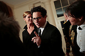 Film producer and director J.J. Abrams right, and Katie McGrath arrive for a state dinner hosted by U.S. President Barack Obama and first lady Michelle Obama in honor of French President Francois Hollande at the White House in Washington, D.C., U.S., on Tuesday, Feb. 11, 2014. Obama and Hollande said the U.S. and France are embarking on a new, elevated level of cooperation as they confront global security threats in Syria and Iran, deal with climate change and expand economic cooperation. <br /> Credit: Andrew Harrer / Pool via CNP