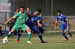 Palestinian Shabab Rafah football club players (in blue) and Shejaiya's football club players (in green) compete during a football match at Palestine Stadium in Gaza city on March 4, 2018. Photo by Mahmoud Ajour