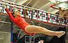 Miranda Lund of Plainview JFK performs on the uneven bars during the NYSPHSAA varsity gymnastics state championship meet at Cold Spring Harbor High School on Saturday, March 3, 2018.