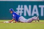 26 July 2013: New York Mets outfielder Juan Lagares slides safely into second during a game against the Washington Nationals at Nationals Park in Washington, DC. The Nationals bounced back from their loss in the first game of their day/night doubleheader, with a 2-1 nightcap win. Mandatory Credit: Ed Wolfstein Photo *** RAW (NEF) Image File Available ***