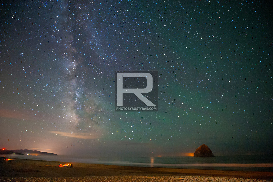 The Milky Way rises over the other Haystack Rock -- this one at Pacific City.