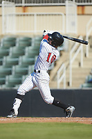 Steele Walker (10) of the Kannapolis Intimidators follows through on his swing against the Greensboro Grasshoppers at Kannapolis Intimidators Stadium on August 5, 2018 in Kannapolis, North Carolina. The Intimidators defeated the Grasshoppers 9-0 in game two of a double-header.  (Brian Westerholt/Four Seam Images)