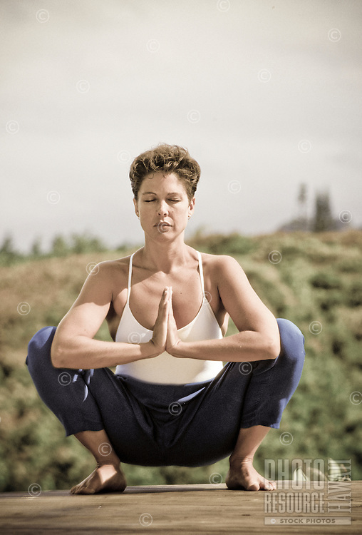 Hatha yoga being performed in the squat position