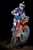 A motocross rider wheelies through the night during and MRAN night race in Logandale, NV.