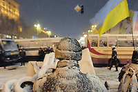 Heavy snow fall on Kiev as the city prepares for violent attack from the police. Tonight the  police is expected to forcedly evacuate the streets from the protesters blocking all the government buildings. Kiev. Ukraine.