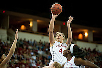 FRESNO, CA--Joslyn Tinkle goes over the top for two points during a 76-60 win over South Carolina at the Save Mart Center for the West Regionals semifinals of the 2012 NCAA Championships.