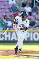 Fernando Pujadas #17 of the Salem-Keizer Volcanoes bats against the Spokane Indians at Volcanoes Stadium on July 26, 2014 in Keizer, Oregon. Spokane defeated Salem Keizer, 4-1. (Larry Goren/Four Seam Images)