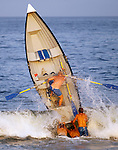 Ted Olsen from Seven President's Oceanfront Park is nearly vertical as he is launched over a wave at the Manasquan Invitational Lifeguard Tournament Aug. 17, 2010.<br /> <br /> photo &copy; 2010 ANDREW MILLS DIGITAL MEDIA LLC.