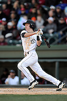 Third baseman Jordan Gore (15) of the South Carolina Gamecocks bats in the Reedy River Rivalry game against the Clemson Tigers on Saturday, February 28, 2015, at Fluor Field at the West End in Greenville, South Carolina. South Carolina won, 4-1. (Tom Priddy/Four Seam Images)