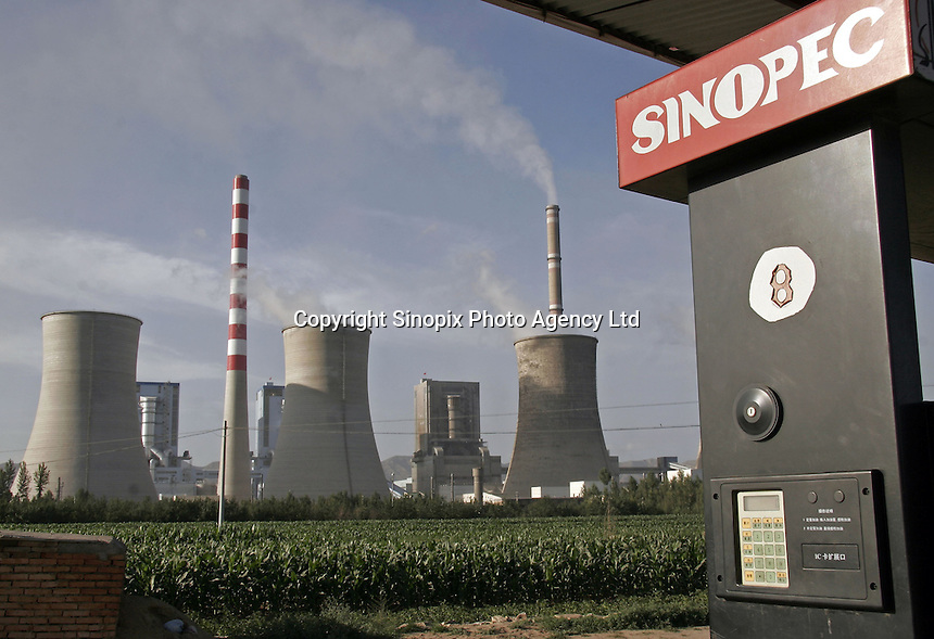 A Sinopec gas station stands close to the Shengtou No. 2 Power Plant near Shuozhou, Shanxi Province, China. While poor in petroleum, China is rich in coal, which the country uses to generate over 75% of its electricity..