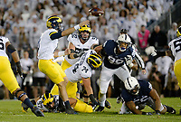 STATE COLLEGE, PA - OCTOBER 21:  Michigan's Mason Cole (52) and Ben Bredeson (74) try to block Penn State DE Yetur Gross-Matos (99), as Michigan QB John O'Korn (8) throws under pressure. The Penn State Nittany Lions defeated the Michigan Wolverines 42-13 on October 21, 2017 at Beaver Stadium in State College, PA. (Photo by Randy Litzinger/Icon Sportswire)