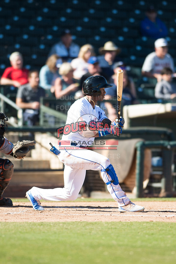 Surprise Saguaros center fielder Nick Heath (21), of the Kansas City Royals organization, hits a single to left field during an Arizona Fall League game against the Glendale Desert Dogs at Surprise Stadium on November 13, 2018 in Surprise, Arizona. Surprise defeated Glendale 9-2. (Zachary Lucy/Four Seam Images)