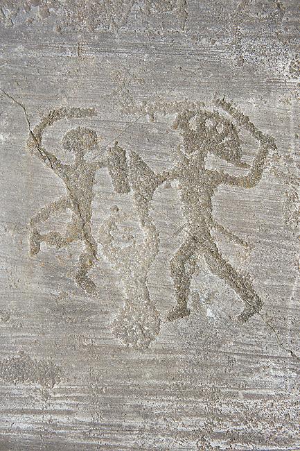 Petroglyph, rock carving, of two feet outlines. Carved by the ancient Camunni people in the iron age between 1000-1200 BC. Foppi di Nadro, Riserva Naturale Incisioni Rupestri di Ceto, Cimbergo e Paspardo, Capo di Ponti, Valcamonica (Val Camonica), Lombardy plain, Italy