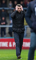 Luton Town Manager Nathan Jones holds his head during the Sky Bet League 2 match between Wycombe Wanderers and Luton Town at Adams Park, High Wycombe, England on 6 February 2016. Photo by Andy Rowland.