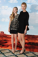 "Amanda Seyfried and Charlize Theron at the photocall for ""A Million Ways to Die in the West"" at Claridges Hotel, London. 27/05/2014 Picture by: Steve Vas / Featureflash"