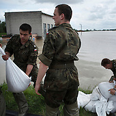 DOBRZYKOW, POLAND, MAY 24, 2010:.Polish soldier carrying sand bags for the anti flood wall..The latest chapter of disastrous floods in Poland has been opened yesterday, May 23, 2010, after Vistula river broke its banks and flooded over 25 villages causing evacualtion of most inhabitants..Photo by Piotr Malecki / Napo Images..DOBRZYKOW, POLSKA, 24/05/2010:.Zolnieze studenci WAT nosza worki z piaskiem.  Najnowszy akt straszliwych tegorocznych powodzi zostal rozpoczety wczoraj gdy Wisla przerwala waly na wysokosci wsi Swiniary kolo Plocka..Fot: Piotr Malecki / Napo Images ..