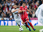 Mats Hummels (R) of FC Bayern Munich competes for the ball with Karim Benzema of Real Madrid during the UEFA Champions League Semi-final 2nd leg match between Real Madrid and Bayern Munich at the Estadio Santiago Bernabeu on May 01 2018 in Madrid, Spain. Photo by Diego Souto / Power Sport Images