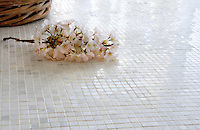1cm Tight Set Grid, a handmade mosaic shown in polished Calacatta Radiance, is part of The Studio Line of Ready to Ship mosaics.