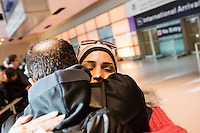 Karam (left, last name withheld), a Syrian with American citizenship living in Portland, Oregon, embraces his fiance (name withheld) after she arrived on a flight from Doha, Qatar, in Logan Airport's Terminal E in Boston, Massachusetts, USA. She had been trying to travel to the US for 3 days but had been denied plane tickets because of President Donald Trump's executive order banning travel to the US by citizens of seven Muslim-majority countries. When Karam found out about flights opening up to Boston that would allow people from Syria to travel, he traveled to Boston from Portland and waited for her arrival.