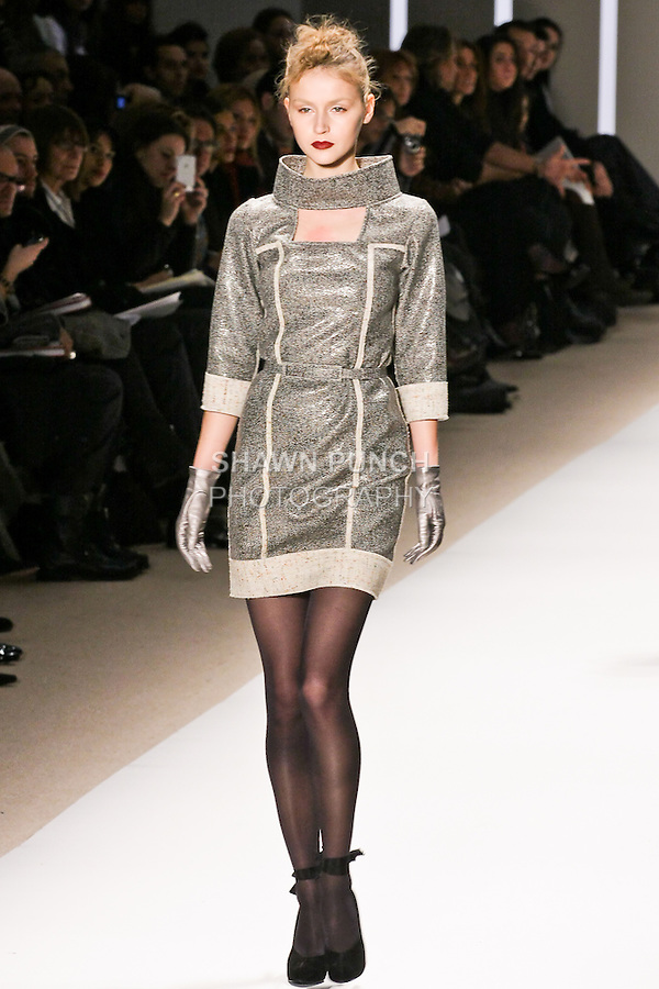 Svieta Nemkova walks the runway in an off white double face cracked wool tweed cocktail dress, by Georges Chakra for the Edition Autumn Winter 2010-2011 collection, during Mercedes-Benz Fashion Week Fall 2010.