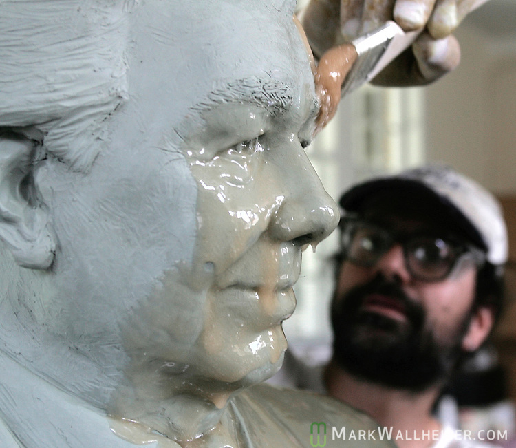 Carl Pelizza, with Inferno Art Foundry in Union City, Georgia, applies urethane rubber, the first step to making a mold to cast  the bronze, to the life-sized clay statue of past president of FSU Bernie Sliger in the studio of Melinda Copper in Monticello, Florida August 3, 2006.