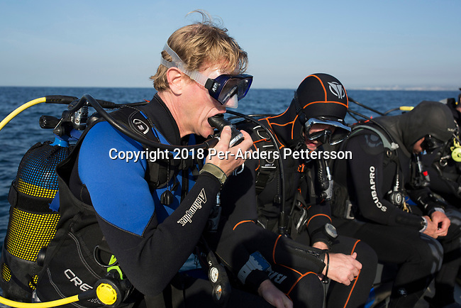 MARGATE, SOUTH AFRICA APRIL 25: Divers start a shark dive, with an African Adventure diving boat, during an early morning dive at Protea Banks on April 25, 2018 in KwaZulu Natal, South Africa. The area is one of the best in South Africa for shark encounters. (Photo by: Per-Anders Pettersson/Getty Images)