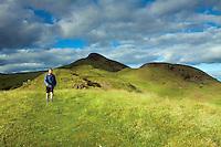 A walker descending from Conic Hill along Druim nam Buaraich, Loch Lomond and the Trossachs National Park