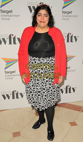GURINDER CHADHA.The Target Women in Film & TV Awards, London Hilton hotel, park Lane, London, England..December 5th, 2008.full length black top white pattern skirt pink red cardigan tights shoes .CAP/CAN.©Can Nguyen/Capital Pictures.