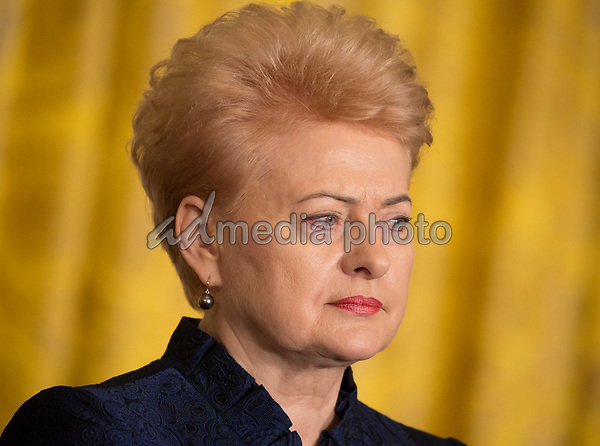 President Dalia Grybauskaite of Lithuania responds to a reporter's question at a Joint Press Conference hosted by United States President Donald J. Trump with the other Baltic States Heads of Government, President Raimonds Vejonis of Latvia, and President Kersti Kaljulaid of Estonia in the East Room of the White House in Washington, DC on Tuesday, April 3, 2018. Photo Credit: Chris Kleponis/CNP/AdMedia