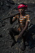 Jai Bhujian, a daily wage labourer poses for a portrait in Goladi coal depot in Jharia, outside of Dhanbad in Jharkhand, India.  Photo: Sanjit Das/Panos