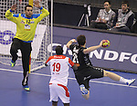 15.01.2013 Granollers, Spain. IHF men's world championship, prelimanary round. Picture show Vasko Sevaljevic  ans Maroaune Magaiez   in action during game between Tunisia vs Montenegro at Palau d'esports de Granollers