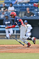 Hagerstown Suns shortstop Edwin Lora (4) starts down the first base line during a game against the Asheville Tourists at McCormick Field on April 27, 2016 in Asheville, North Carolina. The Tourists defeated the Suns 14-7. (Tony Farlow/Four Seam Images)
