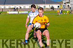 Listowel V Annascaul : Listowel Emmets Bryan Sweeney wins the ball ahead of Annascaul's Eoin Curry in their Castleisland Junior Premier Club Championship game in Frank Sheehy Park, Listowel on Saturday evening last.