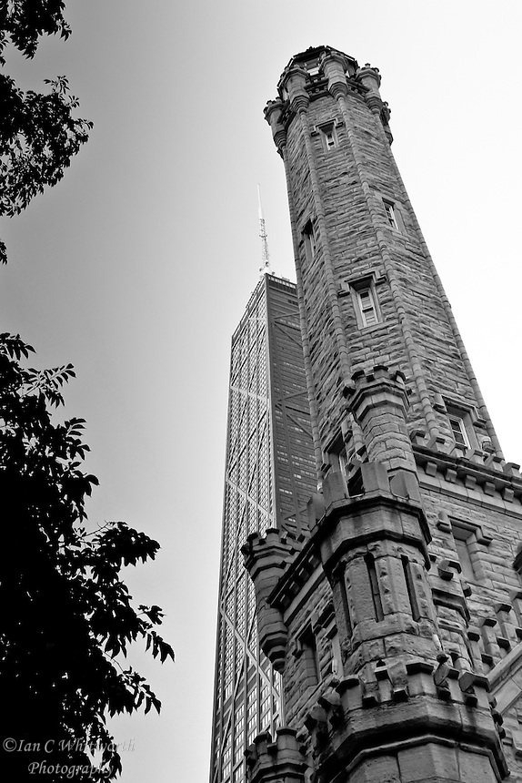 A black and white view of the old and new buildings in Chicago